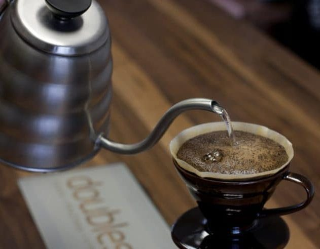 Making drip coffee using pour over cone